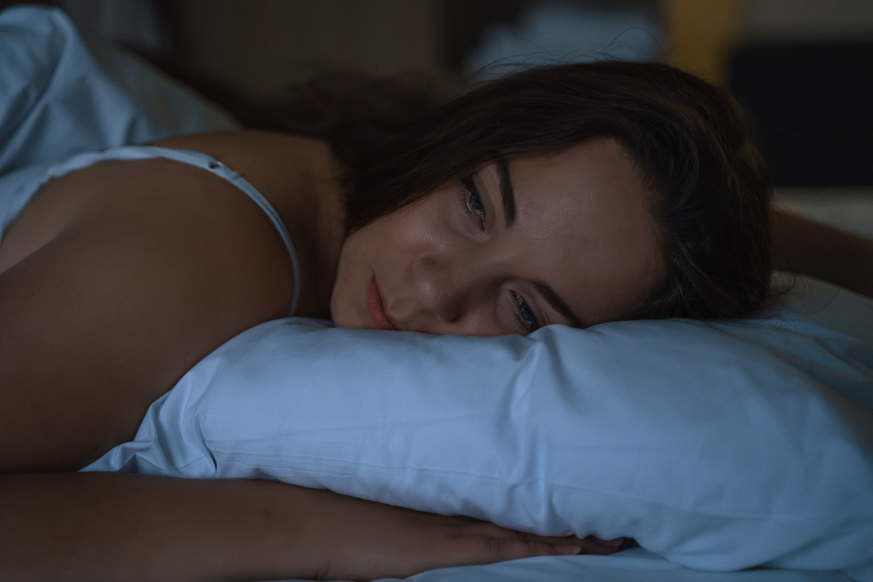 A woman experiencing insomnia