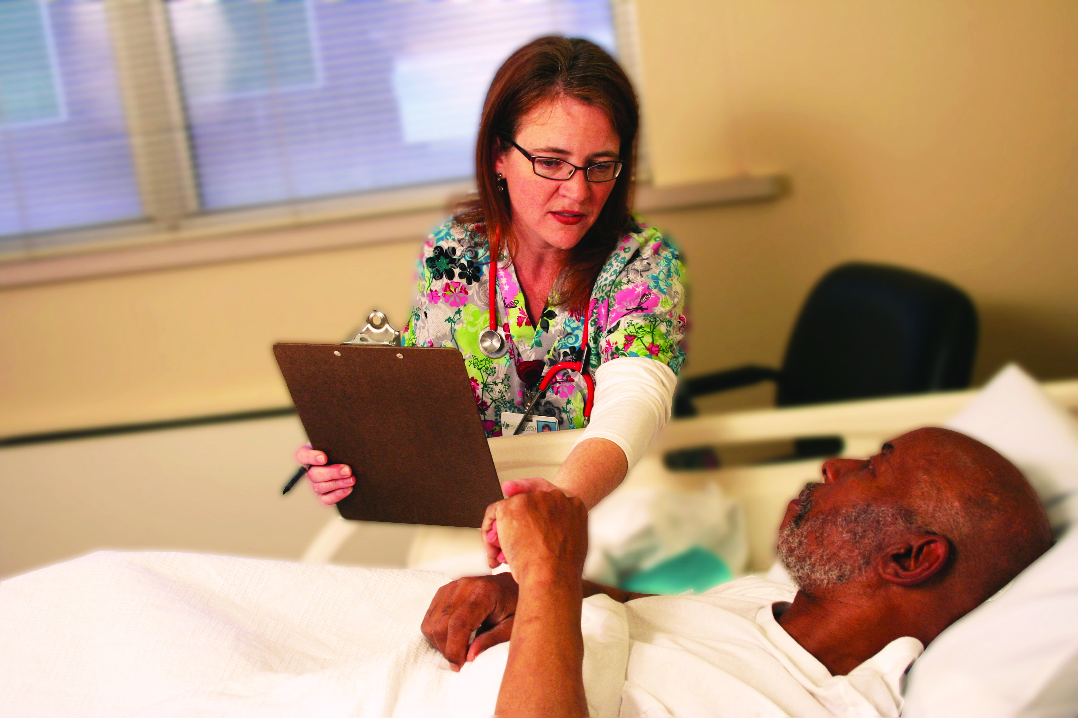 A specialized nurse assists a patient in the Geriatric Psychiatry Unit at UAB Medical West.